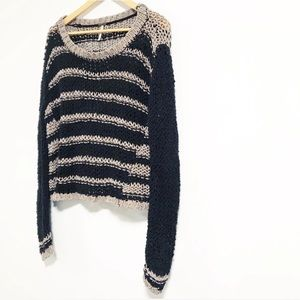 Free People. Loose knit striped sweater.